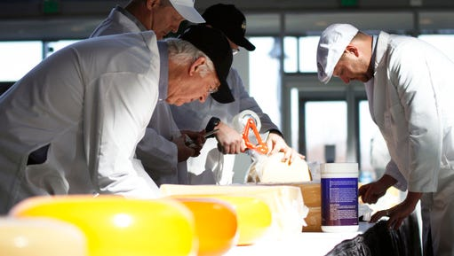 In this photo taken Tuesday, March 7, 2017, judge William Wangerin, front, and three other judges consider cheeses at the U.S. Championship Cheese Contest in Green Bay, Wis. The contest organizer, Wisconsin Cheese Makers Association, says the number of cheeses, yogurts and butters competing at this year's event is at an all-time high. They say it's because cheesemakers are seeing what a win does for sales. Judging was set for Tuesday and Wednesday, with winners announced Thursday.