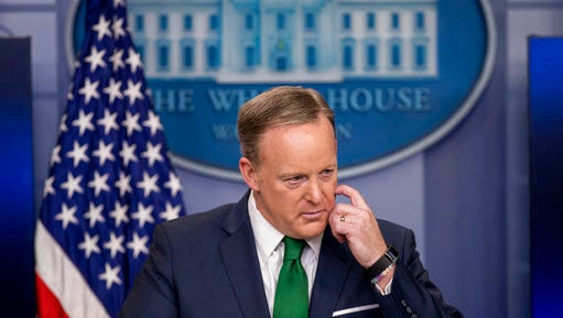 White House press secretary Sean Spicer takes a question during the daily press briefing at the White House in Washington, Thursday, March 16, 2017. Spicer discussed President Donald Trump's assertion that former President Barack Obama wire tapped him, the Trump Administration's proposed budget, and other topics.