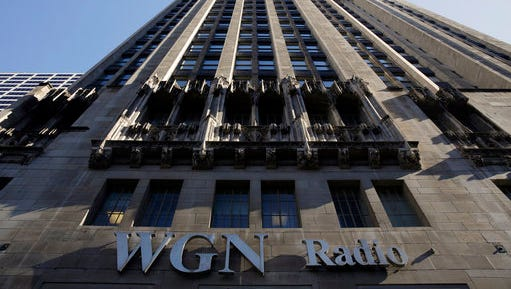 The WGN Radio sign appears on the side of Tribune Tower, Monday, May 1, 2017, in downtown Chicago. TV station operator Tribune Media is at the center of a possible bidding war, following reports that Fox News owner 21st Century Fox and investment firm Blackstone may make a joint takeover bid for the company. Tribune owns or operates 42 local TV stations across the nation, including WPIX in New York, KTLA in Los Angeles and WGN in Chicago.