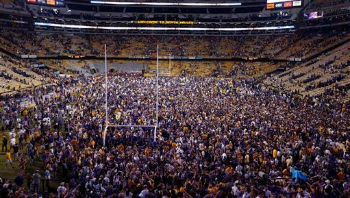 LSU fans swarm the field after their victory over Mississippi Saturday. LSU won 10-7.