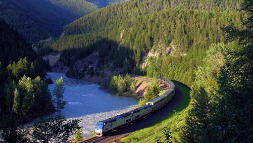 In this photo taken on June 26, 2011, Amtrak's Empire Builder makes its way along the southern boundary of Glacier National Park near West Glacier, Mont.Extreme freight congestion in the northern plains, particularly in North Dakota?s Bakken region, has resulted in major delays for Amtrak?s passenger service between Chicago and Seattle and Portland. Five years after the Empire Builder had some of Amtrak?s best on-time performance rates, even outpacing Amtrak?s high-speed Acela train between Boston and Washington, delays of three to five hours are now commonplace. (AP Photo/Flathead Beacon, Justin Franz)