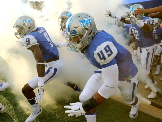 MTSU players take the field before the start of the