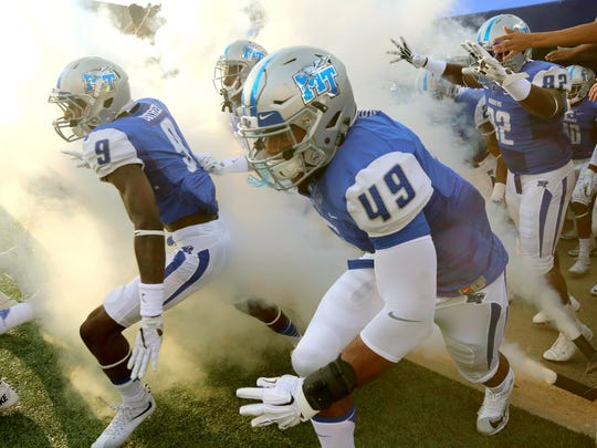 MTSU players take the field before the start of the NCAA college football game against Jackson State, on Saturday, Sept. 5, 2014, in Murfreesboro, Tenn.