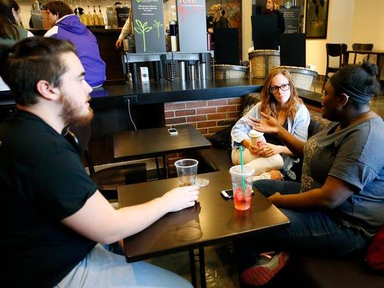 Elmira College sophomore Stephen Morganti, recent graduate Irina Ivanova and junior Fabiola Bien-Aime hang out inside the new Starbucks at Elmira College Tuesday. The coffee house also serves the public.