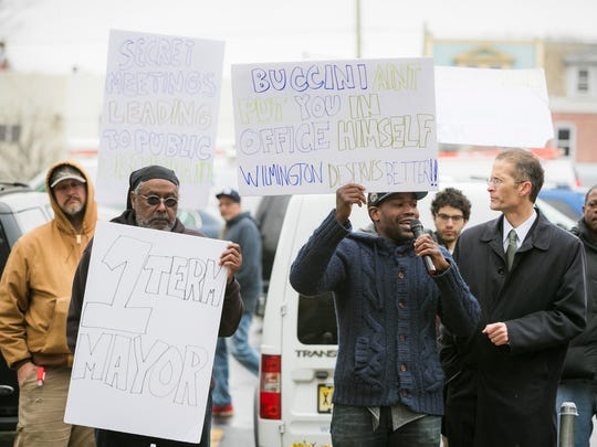 The Coalition to Keep Bus Service on Rodney Square rallies in Wilmington in April. The group filed a complaint this week asking the Department of Justice to step in and order Gov. John Carney's emails be uncovered.