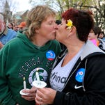 Engaged couple Monica Murray, left, and Dawn Smith, right, both of Lansing, kiss as they take part with other supporters of same-sex marriage in a rally and candlelight vigil at the Capitol Monday evening 4/27/2015. The event, sponsored by Michigan for Marriage, brought together people from across the state on the eve of Tuesday's US Supreme Court oral arguments on the issue.