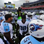Titans outside linebackerd Derrick Morgan (91) and Brian Orakpo (98) get the team fired before the start of the game against the Colts on Sept. 27, 2015.