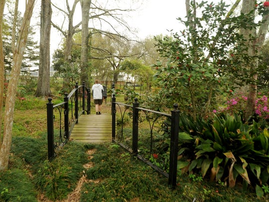 The garden bridge leads to more of the Schoefler's expansive, natural areas  in the backyard of the home.