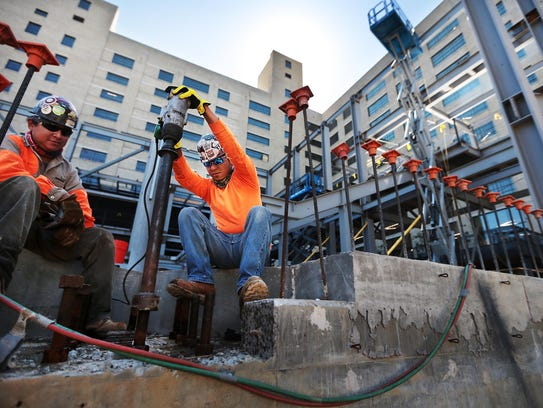 Miguel Criz (left) and Victor Valazquez work on the