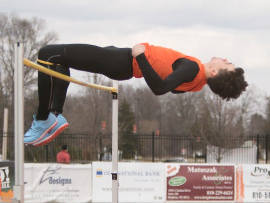 Noah Grimm of Brighton clears 6 feet, 4 inches in the