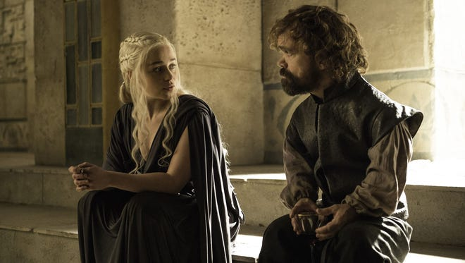 HBO has made deals with four top writers to develop potential spinoffs of 'Game of Thrones,' which stars Emilia Clarke, left, and Peter Dinklage.