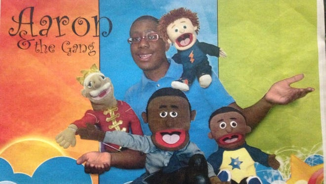 Senior Aaron Hightower plays with puppets as he practices for youth ministry.