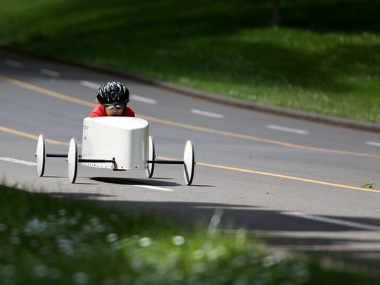 Danica Weathers, 9, races in the 20th Annual Soap Box Derby at Bush's Pasture Park on Saturday, May 23, 2015, in Salem, Ore.
