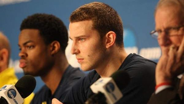 Michigan sophomore guard Nik Stauskas, right, gained experience last year and is back for more in the NCAA tournament.