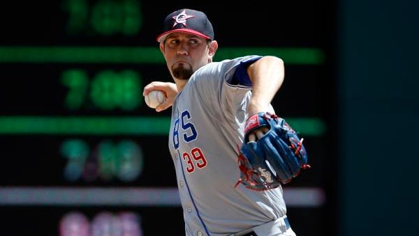 Chicago Cubs starting pitcher Jason Hammel throws during a baseball game against the Washington Nationals at Nationals Park, Friday, July 4, 2014, in Washington.