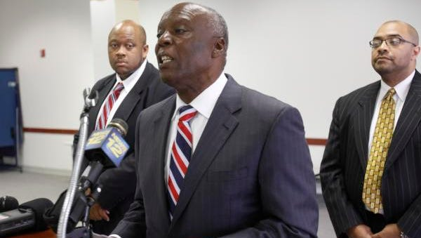 Spring Valley Mayor Demeza Delhomme flanked by town attorneys Jerrold Miles and Corey Turner at a press conference at the Louis Kurtz Civic Center in Spring Valley on July 15, 2014.