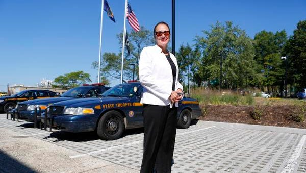 Deborah Bradley, president of Deborah Bradley Construction and Management Services, stands in the New York State Police Zone 1 barracks in West Nyack where her company built up the surrounding property which included wall, curbs and pavers.  Sept. 4, 2014.