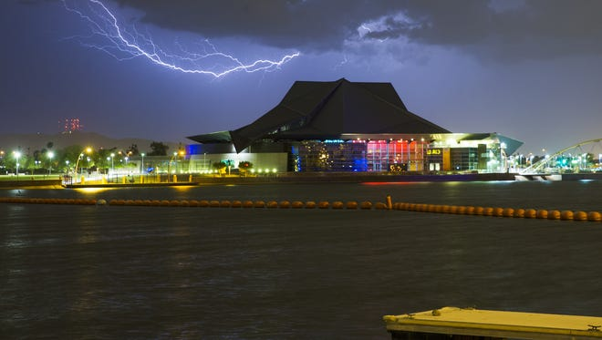 Lightning strikes over the Tempe Center for the Arts durng a monsoon storm August 10, 2016.