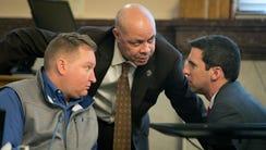 Cincinnati City Manager Harry Black, center, talks