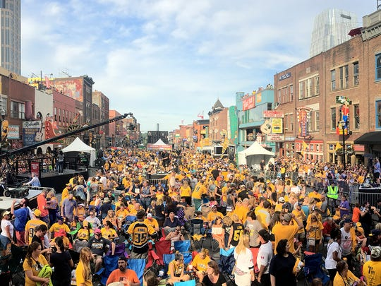 The crowd lines Lower Broadway for the Stanley Cup