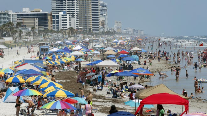 """Holiday weekend crowds pack the shoreline on Memorial Day weekend in Daytona Beach. """"We're in the midst of something fantastic, everywhere we look,"""" said Lori Campbell Baker, executive director of the Daytona Beach Area Convention & Visitors Bureau. The county hosted a record 10.2 million visitors in 2018, a sixth consecutive record-setting year, but Florida Department of Revenue statistics show that the area's tourism growth lags behind most other coastal destinations."""