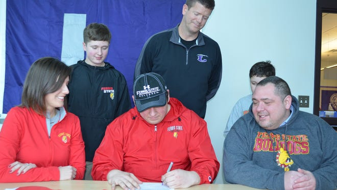 Lakeview's Cameron Wirtz signs to play for Ferris State. He is joined by his parents, Erin and Bryan Wirtz, brothers Jackson and Dominic Wirtz and Lakeview football coach Matt Miller.