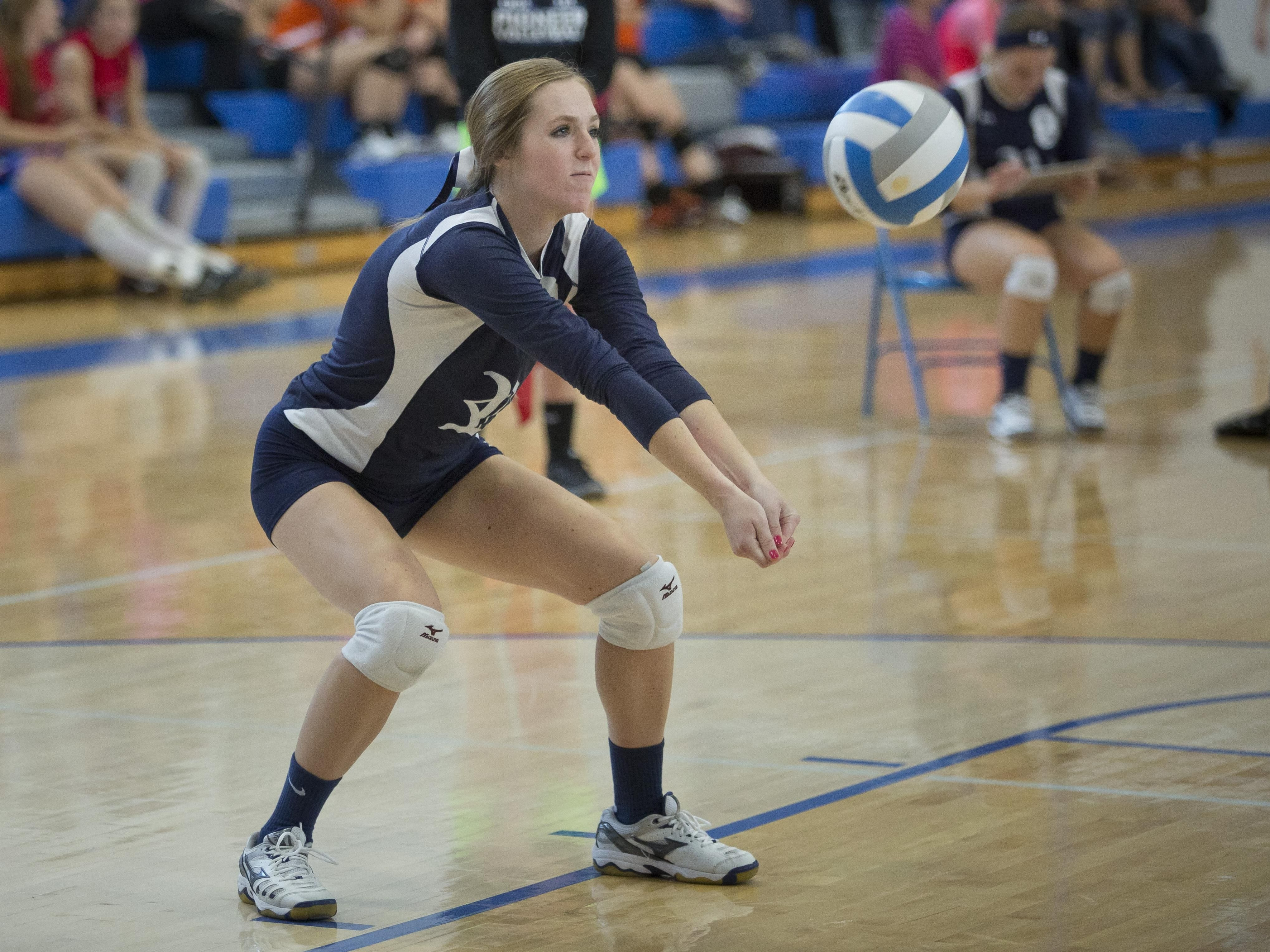 Richmond's Lindsay Schweiger bumps the ball during the Pioneer Volleyball Invitational Saturday, September 12, 2015 at Cros-Lex High School.