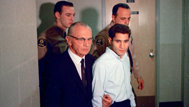 Sirhan Sirhan, right, the suspect of shooting Sen. Robert F. Kennedy is seen in June 1968 with his attorney Russell E. Parsons in Los Angeles.   Sirhan Sirhan was convicted of killing Robert F. Kennedy.