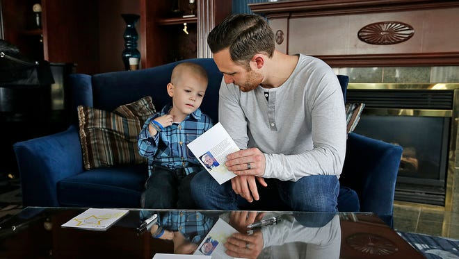 Four-year-old Beckett Roerdink of Greenville designed this greeting card and had it signed by Milwaukee Brewers catcher Jonathan Lucroy in Milwaukee. Beckett was diagnosed with a brain tumor in 2013 and was meeting Milwaukee Brewers player Jonathan Lucroy there through the Catch a Star program.