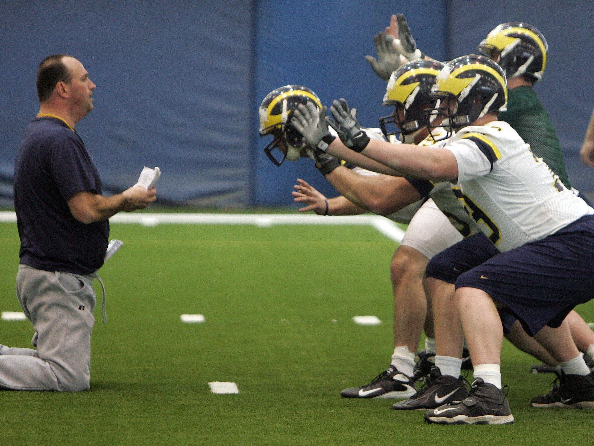 Michigan offensive line Greg Frey watches his team in formation for a field goal kick during spring football practice at the Oosterbaan Field House on March 15, 2008.