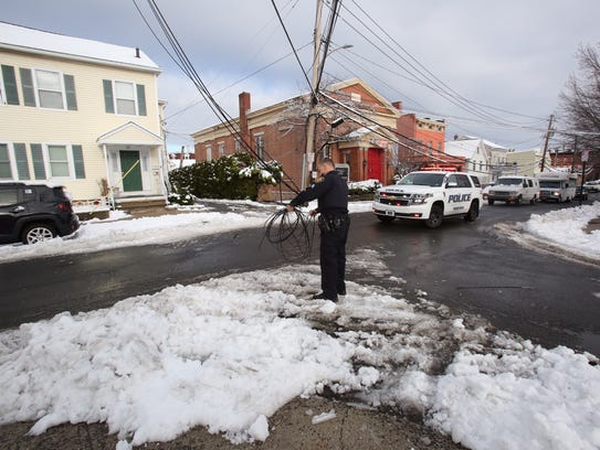 8:23 a.m.: An officer clears a downed wire in Tarrytown