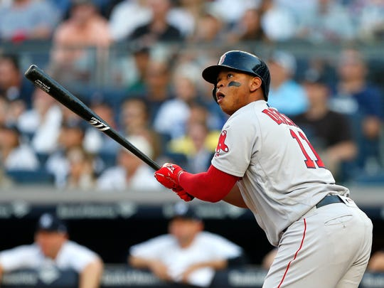 Jun 30, 2018; Bronx, NY, USA; Boston Red Sox third baseman Rafael Devers (11) watches the ball go into the stand for a grand slam against the New York Yankees in the first inning  at Yankee Stadium.