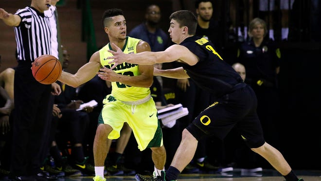 Baylor Bears guard Manu Lecomte (20) is guarded by Oregon Ducks guard Payton Pritchard (3) during the first half at Ferrell Center.