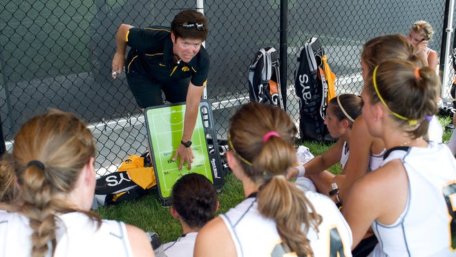 Iowa women's field hockey coach Tracey Griesbaum works with Hawkeye players in a file photo submitted by the university.