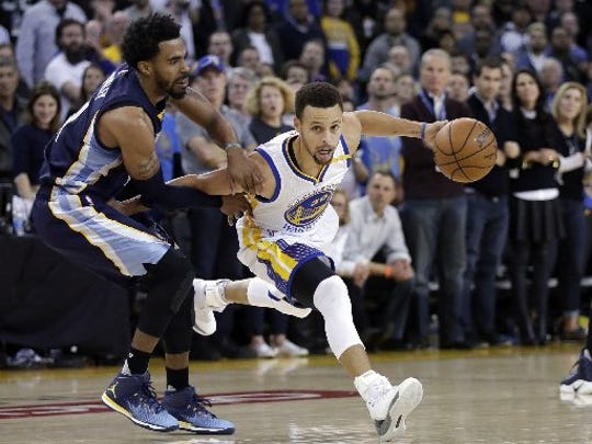 Golden State Warriors' Stephen Curry (30) dribbles next to Memphis Grizzlies' Mike Conley during the second half of an NBA basketball game Friday, Jan. 6, 2017, in Oakland, Calif. Memphis won 128-119.