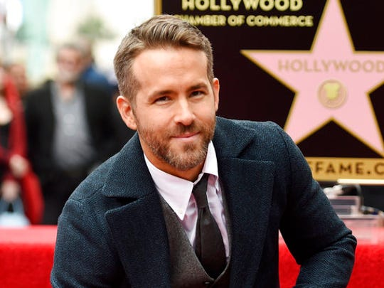 "FILE - In this Dec. 15, 2016, file photo, actor Ryan Reynolds poses at a ceremony honoring him with a star on the Hollywood Walk of Fame in Los Angeles. There's a bromance brewing between actors Jake Gyllenhaal and Reynolds. The Hollywood stars say they hit it off so well during the filming of their new sci-fi thriller called ""Life"" that a genuine friendship has blossomed."