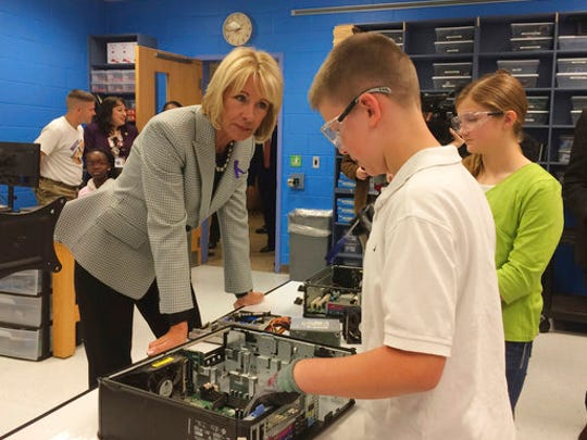 Education Secretary Betsy DeVos meets with students at Ashland Elementary School in Manassas, Va., Tuesday, April 25, 2017, where many children's parents serve in the military, during a visit of the school in recognition of the Month of the Military Child.