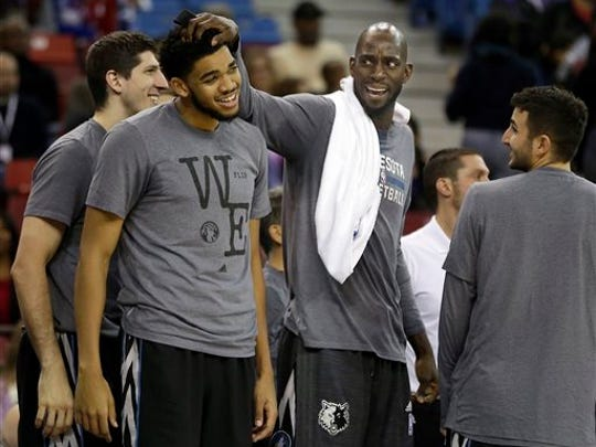Karl Towns, left, with Kevin Garnett on the T-Wolves'