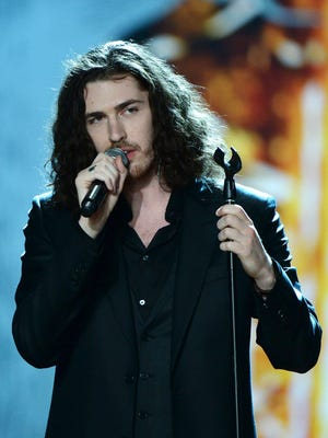 Irish singer Hozier performs during the 2014 Victoria's Secret fashion show at the Exhibition Centre in Earls Court in central London on Dec. 2, 2014.