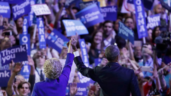 President Barack Obama and Democratic presidential nominee Hillary Clinton acknowledge the crowd Wednesday night at the Democratic National Convention.