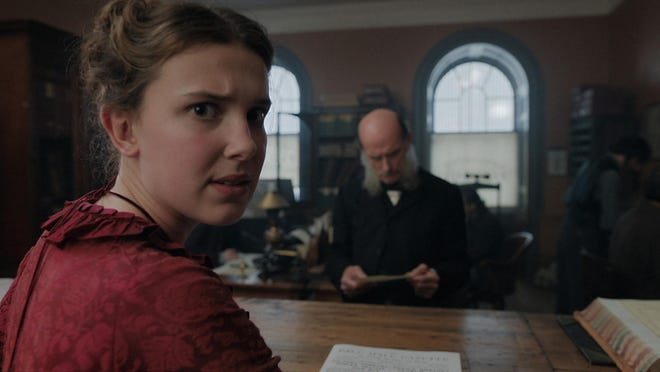 "Millie Bobby Brown in the movie ""Enola Holmes."""