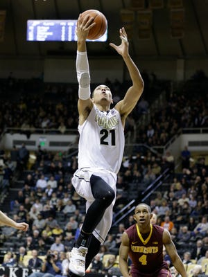 Purdue guard Kendall Stephens (21) shoots over Minnesota guard DeAndre Mathieu (4) in the second half of an NCAA college basketball game in West Lafayette, Ind., Wednesday, Dec. 31, 2014. Purdue defeated Minnesota 72-68. (AP Photo/Michael Conroy)