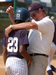 Farragut softball coach David Moore consoles LaShae Wallace after she was tagged out at second base against Beech during the Class AAA tournament in 2008.
