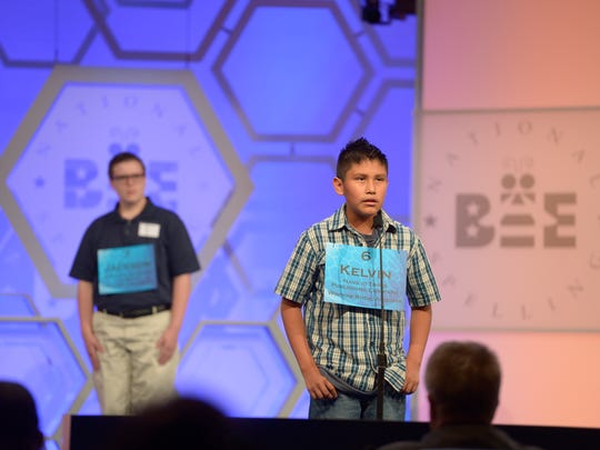 Kelvin Winney of Chinle, Arizona competes in the preliminary rounds of the Scripps National Spelling Bee at National Harbor, Md.