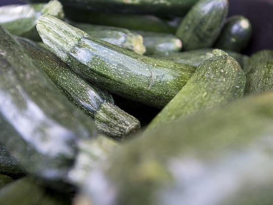 Zucchini is one of the many produce and goods for sale at Whispersholler Farms' at the Asheville Food Park at the corner of Amboy Road and State Street.