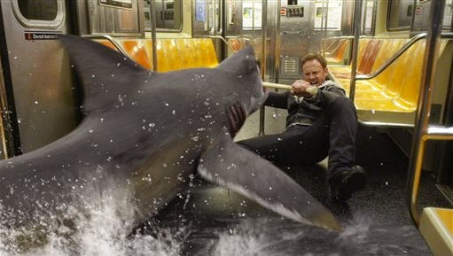 """In this image released by Syfy, Ian Ziering, as Fin Shepard battles a shark on a New York City subway in a scene from """"Sharknado 2: The Second One,"""" premiering Wednesday at 8 p.m."""