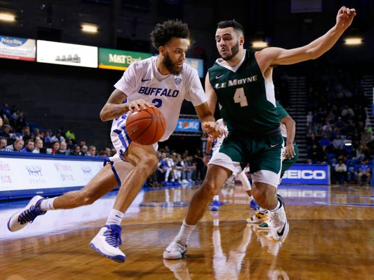 Buffalo guard Jeremy Harris (2) drives against Le Moyne forward Tom Brown (4) during the first half of an NCAA college Basketball game, Wednesday, Dec. 5, 2018, in Buffalo N.Y. (AP Photo/Jeffrey T. Barnes)