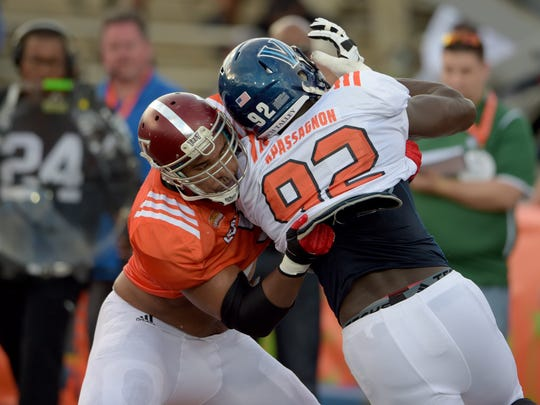 Jan 25, 2017; Mobile, AL, USA; South squad offensive tackle Antonio Garcia of Troy (53) battles defensive end Tanoh Kpassagnon of Villanova (92) in a blocking drill during Senior Bowl practice at Ladd-Peebles Stadium. Mandatory Credit: Glenn Andrews-USA TODAY Sports