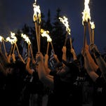 Far-right Golden Dawn supporters lifted torches outside Athens on Sept. 5.