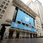 A banner with the logo of Twitter on the front of the New York Stock Exchange in November 2013.